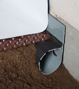 Closeup of a crawl space drainage system installed in Springfield
