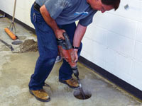 Coring the concrete of a concrete slab floor in Mcminnville