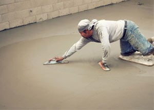 smoothing out the grout in a slab releveling project in Philpot