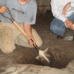Digging a hole for the engineered fill used in a crawl space support system installation in Philpot