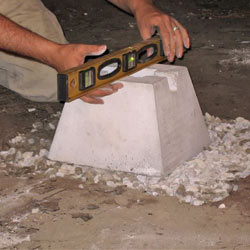 Placing the concrete footer for a crawl space jack post