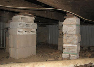 crawl space repairs done with concrete cinder blocks and wood shims in a Antioch home