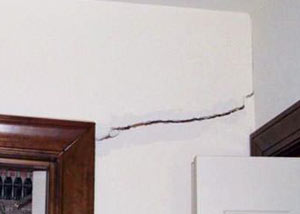 A large drywall crack in an interior wall in Bowling Green