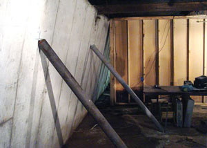 A severely tilting foundation wall propped up by steel beams in Gallatin.