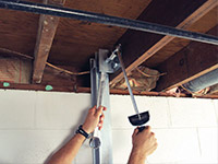 Straightening a foundation wall with the PowerBrace™ i-beam system in a Marion home.