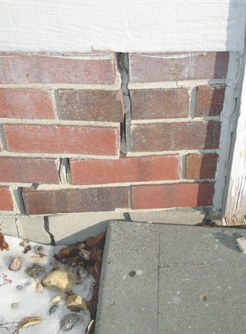 Severe street creep damage to a garage wall outside a Smyrna home