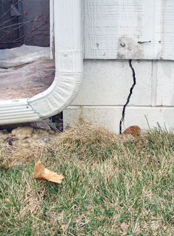 foundation wall cracks due to street creep in Sparta
