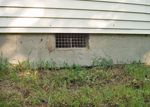 Open crawl space vents that let rodents, termites, and other pests in a home in Franklin