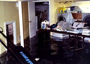 A laundry room flood in Paducah, with several feet of water flooded in.