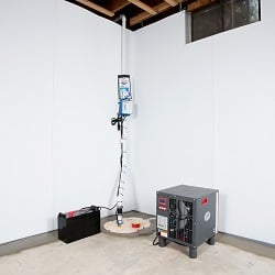 Sump pump system, dehumidifier, and basement wall panels installed during a sump pump installation in Paducah