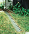 A recessed gutter drain extension installed in Brentwood, Tennessee and Kentucky